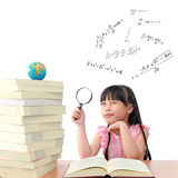 Genius girl reading book. Genius little girl reading the book Royalty Free Stock Photo