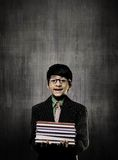 Genius Little Boy Holding Books Wearing Glasses, Smiling Near C Stock Photos