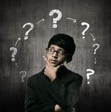 Genius Little Boy Wearing Glasses, Ring Of Question Marks Royalty Free Stock Photo