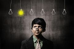 Genius Little Boy Wearing Glasses, Thinking Ideas Bulbs Hanging Stock Photo