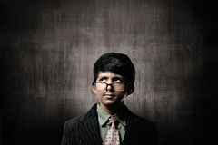 Genius Little Boy Wearing Glasses, Thinking Near Chalkboard Royalty Free Stock Photo