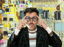 Genius nerd electronic engineer tech man thinking. Gesture electronics motherboard chip background Stock Photo