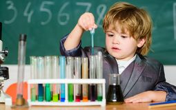Genius pupil. Education concept. Experimenting with chemistry. Talented scientist. Boy test tubes liquids chemistry royalty free stock images