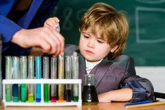 Genius pupil. Education concept. Talented scientist. Boy test tubes liquids chemistry. Chemical analysis. Knowledge day royalty free stock photos