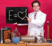 Genius shows mathematical formula Royalty Free Stock Photos