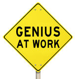Genius At Work Yellow Road Sign Warning. The words Genius at Work on a yellow road sign to give you warning that someone smart, brilliant, intelligent or stock illustration