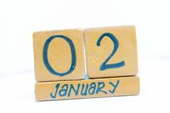 2 gennaio Giorno 2 del mese, calendario su fondo di legno Orario invernale, concetto di anno fotografie stock