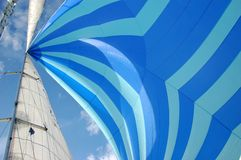 Gennaker. Blue Gennaker and main sail while sailing royalty free stock photography