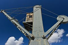 Genoa. Ancient crane at the port stock photos
