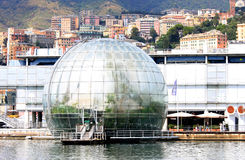 Genoa Biosphere in the old harbor in Italy. The Bull of the Biosphere, the glass ball in front of the Aquarium of Genoa internally recreates a natural habitat Royalty Free Stock Image