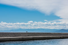 Genoa breakwaters. The Genova breakwater during a  warm summer day with blue sky and clouds. Genova, Italy Stock Photos