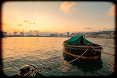 Genoa cityscape with boat, grunge photography with border grain. Stock Photos