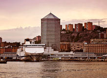 Genoa harbor with the Matitone tower at sunset Royalty Free Stock Photo