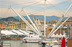 Genoa, Italy - Antique harbor(Porto Antico) at dusk Stock Photos