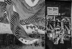 Genoa, Italy - April 21, 2016: Black and white grafiti on the. House walls in Genoa, Italy royalty free stock photos
