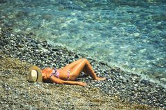 Woman standing at the beachin the summer in Gonoa. Genoa, Italy - August 02 2011: Woman standing at the beachin the summer in Gonoa royalty free stock image