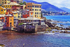 Genoa, Italy - Boccadasse, painted houses on the bay Royalty Free Stock Images