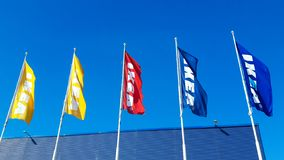 Ikea flags against sky at the Ikea store. Ikea is the world`s largest furniture retailer and royalty free stock photo