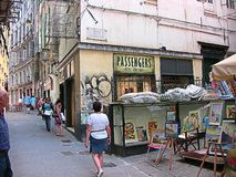 Genoa, Italy, Liguria, old town alley. Genoa, Liguria, Italy - July 25, 2014: old town alley, called Luccoli street, in the Sestiere del Molo, between the harbor royalty free stock images