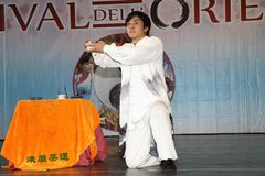 Genoa-Italy March 8, 2019: The Chinese Kung Fu Tea of the master Jin Gang Xiaosci at the festival of the East of Genoa. The tea ceremony along with the kung fu royalty free stock image