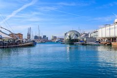 Genoa harbors with the city skyline and the biosphere, Ligurian Sea. The glass-and-steel ball located in the sea next to the aquarium houses butterflies, iguanas royalty free stock image