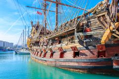 Old harbor with a replica of a historic pirate ship in Genoa. Italy stock image