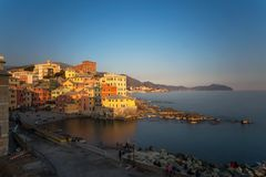 View of Genoa Boccadasse at sunset,  a fishing village with colorful houses in Genoa, Italy stock images