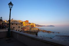 View of Genoa Boccadasse at sunset,  a fishing village with colorful houses in Genoa, Italy royalty free stock photos