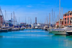 Yachts and boats in the old harbor with a lighthouse in Genoa. GENOA, ITALY - MARCH 9, 2019: Yachts and boats in the old harbor with a lighthouse in Genoa,Italy stock photos