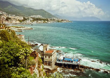 Genoa, Italy - panoramic view of city coastline on the Ligurian. Genoa, Italy - panoramic view of city coastline  and a small  private bathing resort on the Royalty Free Stock Photography