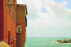 Genoa Italy -red house on the sea royalty free stock photography