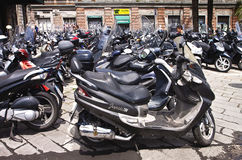 Genoa, Italy- scooter parking in city center stock image