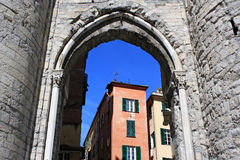 Genoa, Italy. View through the arch to the old city houses Stock Photo
