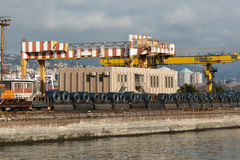 Genoa Port, dockside cranes and roll steel coil Royalty Free Stock Photos