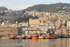 Genoa from the sea. Tugboat moored in front of the historic center of Genoa, Italy Royalty Free Stock Photos