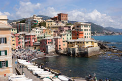 Genoa - the small beach of Boccadasse borough - Liguria. Genoa, Boccadasse, Italy - April 24, 2017: People enjoy the wonderful day on the small beach of royalty free stock photography
