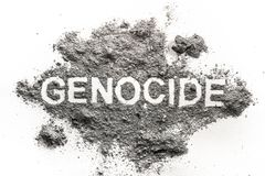 Genocide word written in ash, sand or dust royalty free stock photos