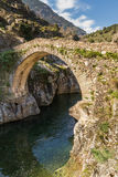 Genoese bridge at Asco in Corsica. The ancient Genoese bridge over the Asco river at Asco in Corsica royalty free stock photos