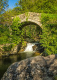 Genoese bridge and cascade near Feliceto in Corsica Royalty Free Stock Photo