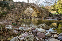 Genoese bridge at Piana in Corsica. Stream passing through an ancient Genoese bridge in the village of Piana in the Balagne region of Corsica royalty free stock image