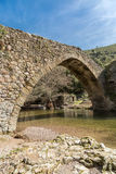 Genoese bridge at Piana in Corsica. Stream passing through an ancient Genoese bridge in the village of Piana in the Balagne region of Corsica stock photography