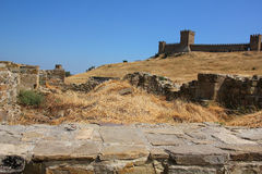 Genoese fortress. Ruins of ancient fortress wall and tower stock photography