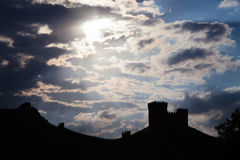 Genoese fortress silhouette with blue sky and clouds Royalty Free Stock Photos