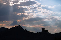 Genoese fortress silhouette with blue sky and clouds Royalty Free Stock Image