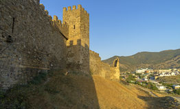 Genoese fortress in Sudak, Crimea.  The shadow of the tower on the fortress wall. Royalty Free Stock Photos