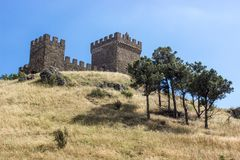 Genoese fortress in Crimea with trees, Sudak. royalty free stock images