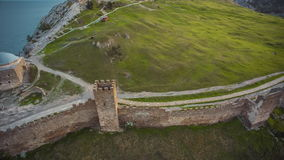 Genoese Fortress. View of the Consular Castle. Aerial shot of the ruins of a medieval fortress on the shore of the Black Sea. Sudak, Crimea stock video