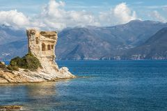 Genoese tower at Mortella near St Florent in Corsica. Ruins of the Genoese tower at Mortella with a turquoise mediterranean sea and rocky coastline of the Desert stock photos