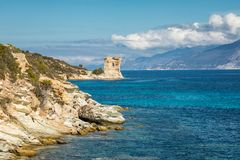 Genoese tower at Mortella near St Florent in Corsica. Ruins of the Genoese tower at Mortella with a turquoise mediterranean sea and rocky coastline of the Desert stock photo