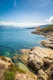 Genoese tower at Mortella near St Florent in Corsica. Ruins of the Genoese tower at Mortella with a turquoise mediterranean sea and rocky coastline of the Desert Royalty Free Stock Photo